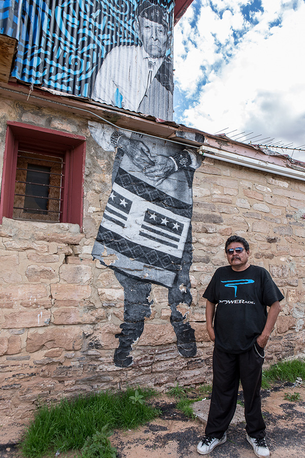 Lorenzo Fowler owns the Old Red Lake Trading Post in Tonalea, AZ. On the wall is an image of his uncle, a respected Navajo Code Talker and Medicine Man who lived to the age of one hundred and one. �Chip's images remind our youth of our culture. It's important�, Lorenzo says. His uncle's picture is a dialogue-opener: �Many people stop by to ask about it�. Those people included us, travelers from Finland. Photo © Maria Jain